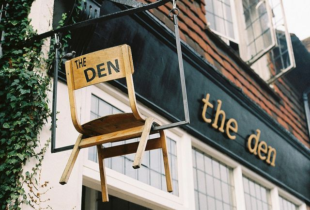 The Den | Ditchling, East Sussex, England  Some sort of 3-D sign above sidewalk in addition to 2-D sign building facade