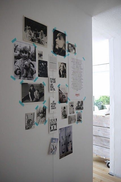 vertical line of black and white photos hung w colorful washi tape on wall to the right of toilet