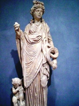 Picture shows Roman woman, Marble, Roman.  Getty Villa.   Women in ancient Rome wear the palla over the stola. The palla used to made of wool and had rectagle shape. The Roman women will put palla on top of her stola when she went outside.