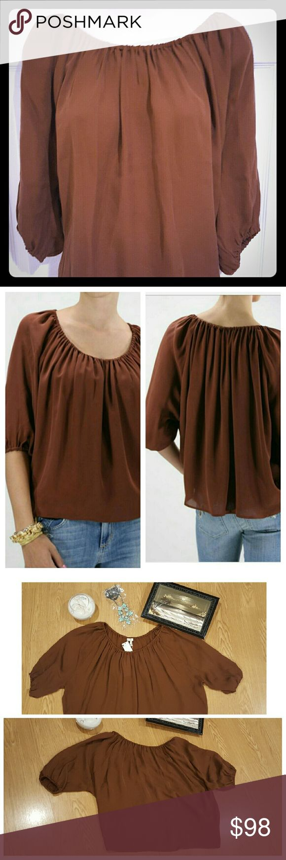 """NWT Newberry Silk Blouse Top New with tags. Joie """"Newberry"""" Silk Blouse with scoop neck. Can also be worn off shoulder for different look. High low waist line. Style # N11-22410. 100% Silk.   Color: Apache Brown  Chest: 32"""" Flat Waist: 22.5"""" Front Length: 22"""" Back Length: 23.5"""" Joie Tops Blouses"""
