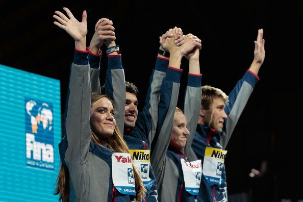 (L-R) Natalie Coughlin, Ricky Berens, Dana Vollmer and Matt Greevers of the USA celebrate on the podium as they accept the award for 'Best Team' on day sixteen of the 15th FINA World Championships at Palau Sant Jordi  on August 4, 2013 in Barcelona, Catalonia.