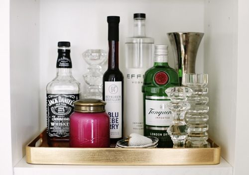 A mini bar in a bookshelf. Mmm. I like that. :)