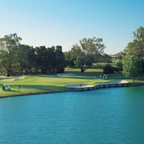 The signature 5th hole with long water carry from tee to green is a feature of the course