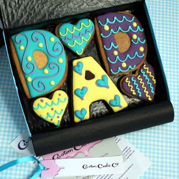 Gift boxed 'DAD' Cookies    5-6 hand decorated cookies - 'D', 'A', 'D' and 2-3 heart cookies. Black gift box contains a ribboned gift tag bearing your special message.    £12 per gift box. Box size - 180mm x 130mm
