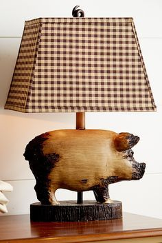 From the tip of the distressed pig figure's nose to the curly tail finial atop the checkered shade, Pier 1's Rodney the Pig Accent Lamp offers a chic farmhouse feel to end tables, nightstands and reading nooks. And you won't have to break your piggy bank to get it.