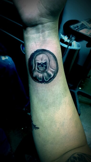 My tattoo of the faceless man coin from Game of Thrones