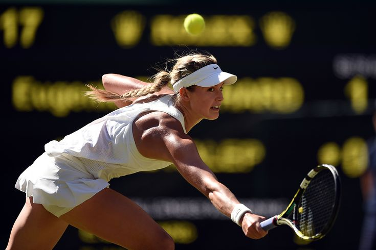 Eugenie Bouchard extends for a backhand on Centre Court - Florian Eisele/AELTC