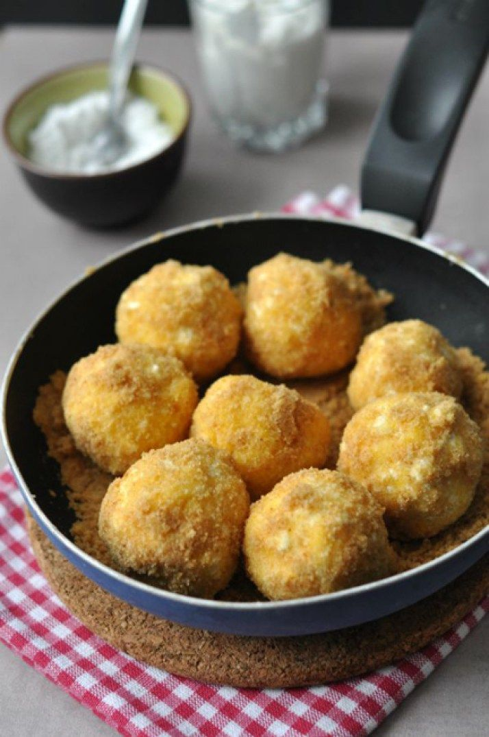 Túrógombóc are curd or cottage cheese dumplings in the shape of balls, boiled in water then covered with buttery bread crumbs and served with warm, sweetened sour-cream sauce.