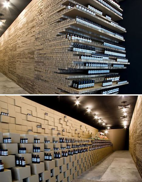 eco-store-design-aesop-cardboard. Aesop's Melbourne location was temporarily made over in 2007 using nothing but industrial-grade cardboard, assembled into boxes and laid out in flat stacks to display the shop's white-labeled glass bottles. The repetition of the textured cardboard along with that of the nearly identical bottles makes for quite an unexpectedly beautiful visual effect.