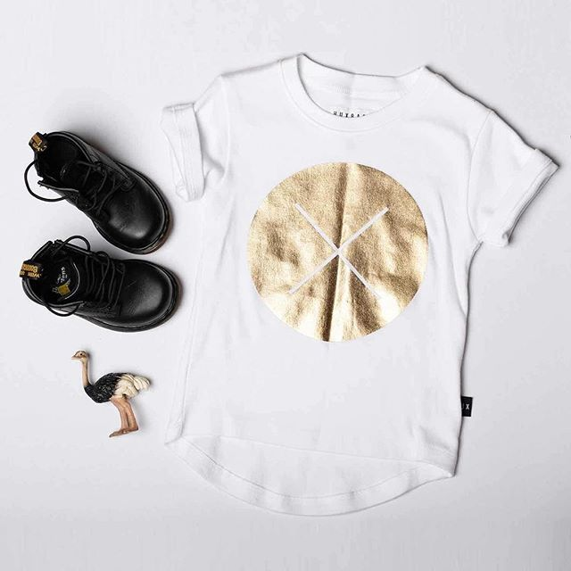 Huxbaby's Gold Circle Cross Tee and Dr Martens Softy T Black Boots, both available at www.babydino.com.au