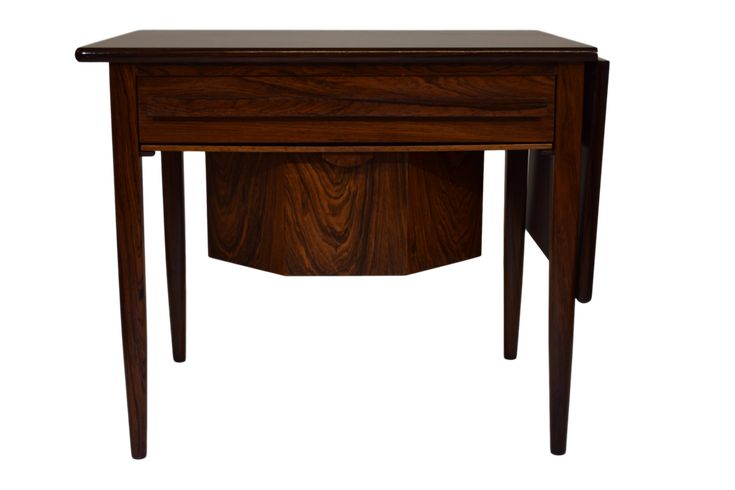 A Danish mid century rosewood sewing table with drop leaf by Johannes Andersen
