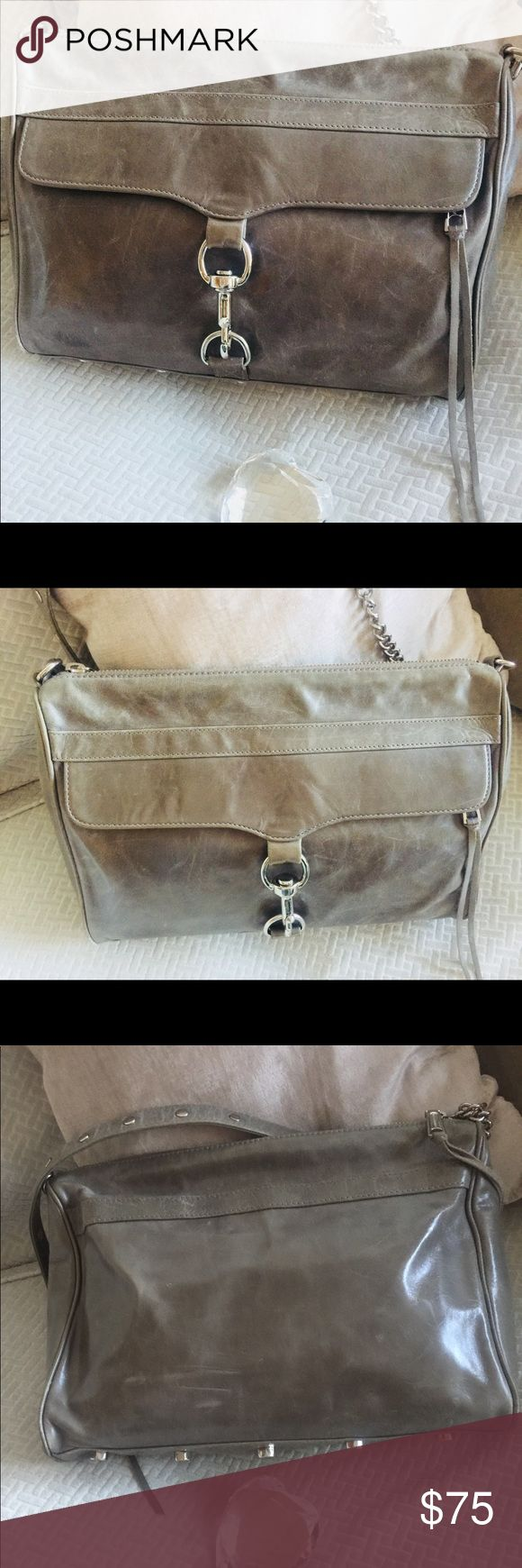 Gorgeous Rebecca Minkoff leather purse/bag! Loved, but in great condition and ready for action! Lovely Rebecca Minkoff bag that's super roomy & versatile. If you a familiar with her bags, the leather is glorious and I love grey over traditional black as a staple for your wardrobe. I wore this both casual, work and travel as I could fit a lot in it and wear it cross body style or just a shoulder bag. Interior is clean with interior zippers for a lipstick, your phone or whatever! Get it at a…