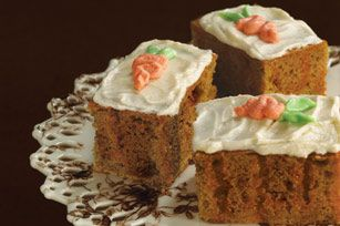 Carrot Poke Cake  Cake: 1 spice cake made up and  2 shred carrots and 1/4 c raisins  bake   Poke holes in cake and pour over 1 c boiling water and 1 box of orange jello , chill and add frost: 4 oz cream cheese, 1/2 t pumpkin spices, 2 c powder sugar....  16 serv.  330 cal.,14 g fat and 0 fiber
