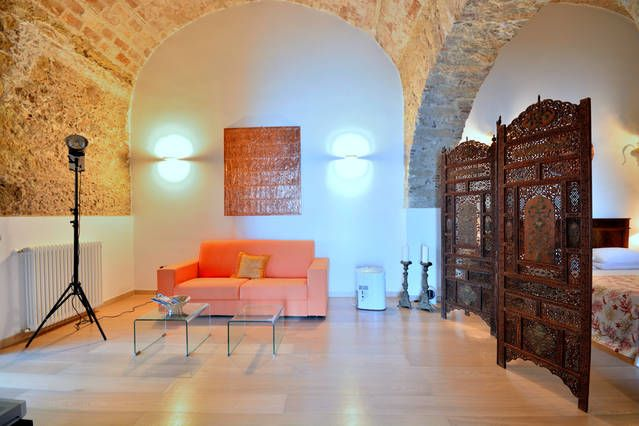living in under a vaulted stone ceiling, Palazzo Pizzo Residence, Calabria, Italy
