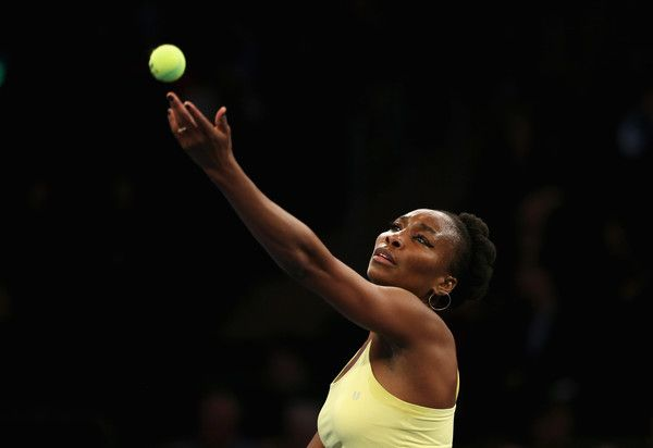 Venus Williams Photos Photos - Venus Williams of Team Americas serves against Garbine Murguza and Kei Nishikori of Team World (not pictured) during their Mixed Doubles match at the BNP Paribas Showdown at Madison Square Garden on March 6, 2017 in New York City. - BNP Paribas Showdown
