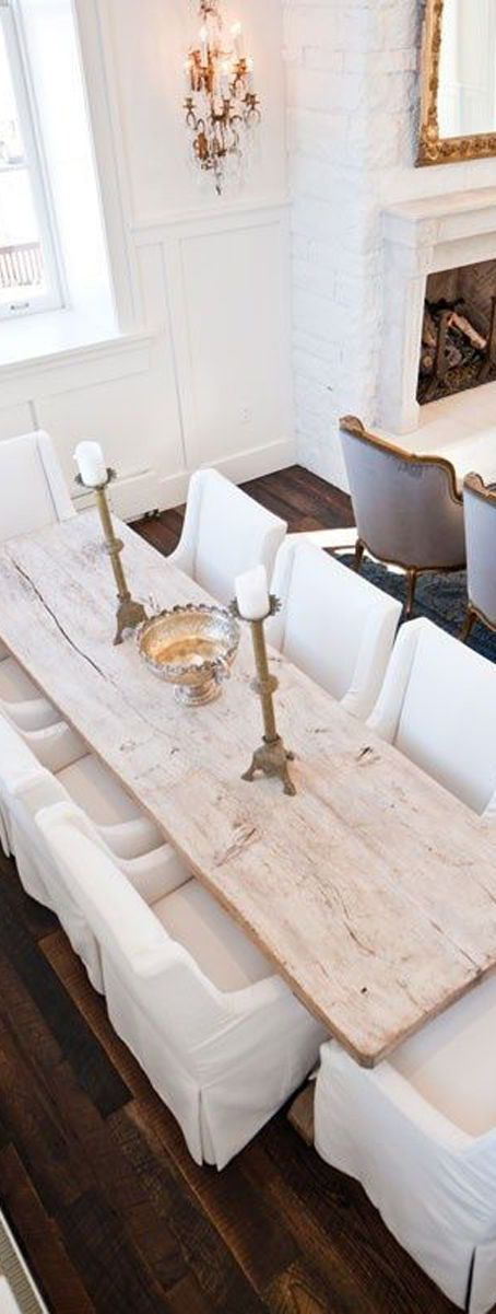 Rustic with the wood meets elegance with the chairs and candle holders