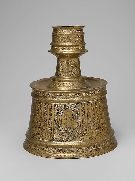 Candlestick with Horsemen and Arabic Inscriptions Conveying Good Wishes and Blessings Upon the Sultan, 13th–14th century, Iran