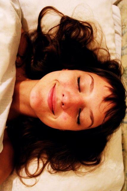 Anna Karina. Happy. In bed.