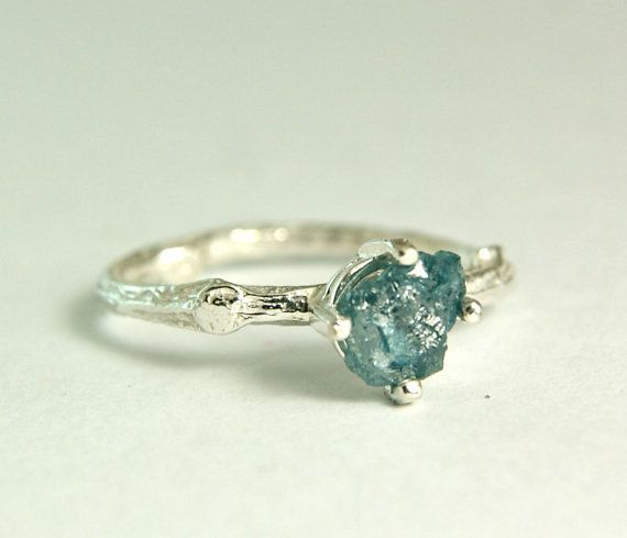 Natural .25ct raw blue diamond set in solid sterling silver. This listing is for one ring. I hand forged this ring from a sheet of .925
