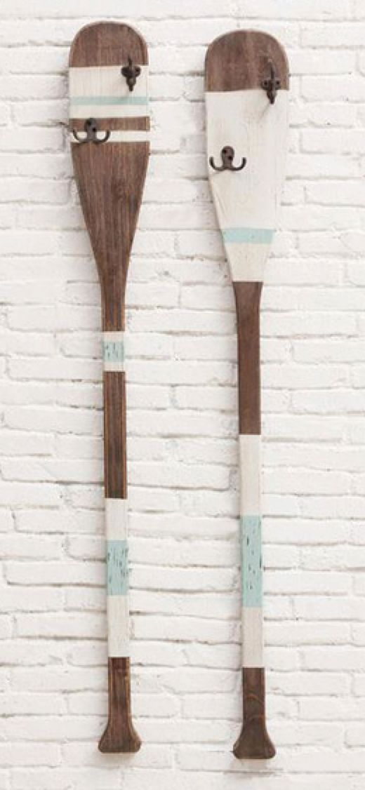 Paint old oars and create hooks or just decoration for patio