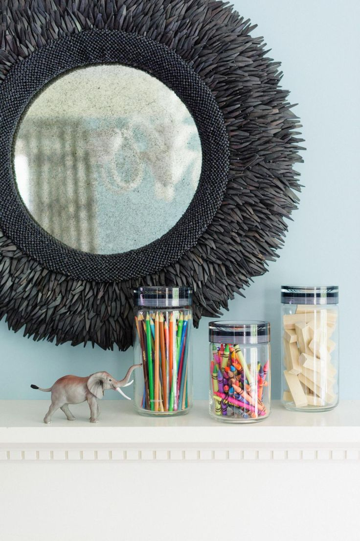 Looking to add more color to your great room without bringing in clutter? Display art supplies in clear acrylic containers to bring a vibrant touch to shelves or built-ins far from children's reach.