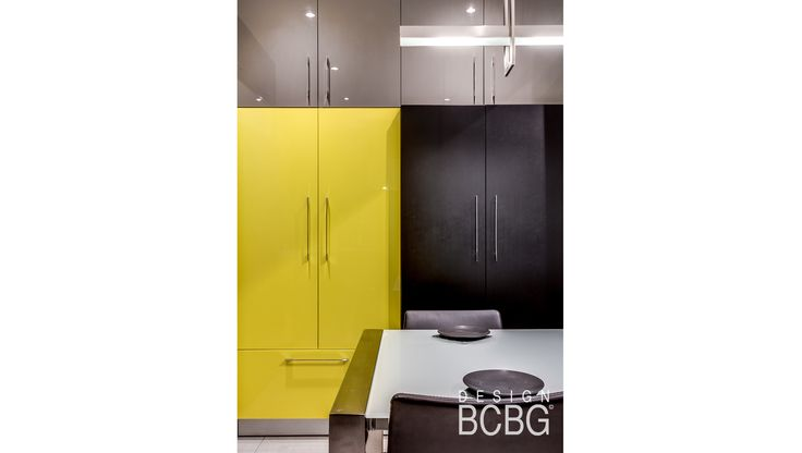Modern kitchen style with maple cabinets painted with grey and yellow lacquer.