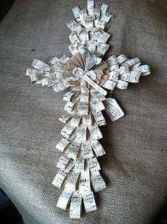 this beautiful palm cross, patterned after the real palm leaf crosses (made with sheet music)