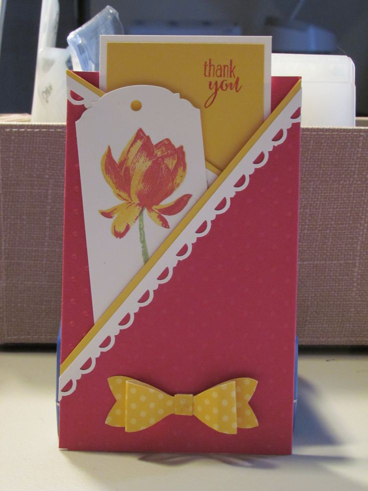 Pocket card using stampin' Up!'s the 2014 Sale-A-Bration Lotus Blossom stamp set, Ornate Tag topper punch, and Bow Builder Punch.