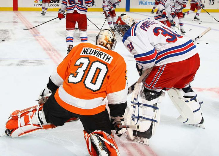 PHILADELPHIA, PA - SEPTEMBER 26: Michal Neuvirth #30 of the Philadelphia Flyers and Ondrej Pavelec #31 of the New York Rangers chat during warm-ups prior to their preseason game at the Wells Fargo Center on September 26, 2017 in Philadelphia, Pennsylvania. (Photo by Bruce Bennett/Getty Images)