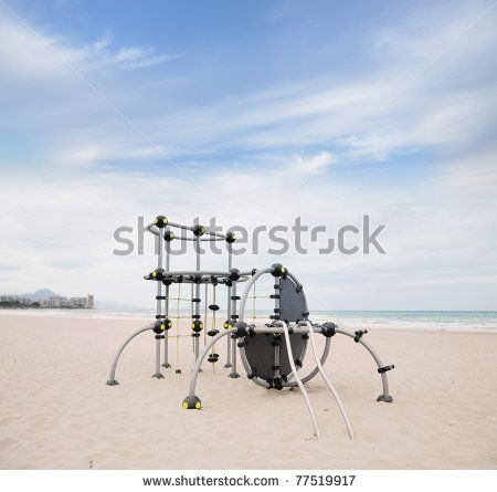 Playground Jungle Gym Equipment for Children on Mediterranean Beach Muchavista in Costa Blanca Alicante Spain Europe Puig Campana and Campello in Background