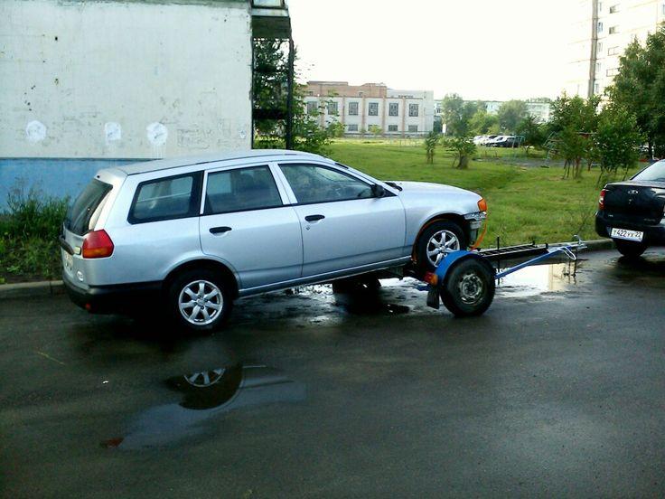 Прицеп для перевозки автомобиля методом частичной погрузки.