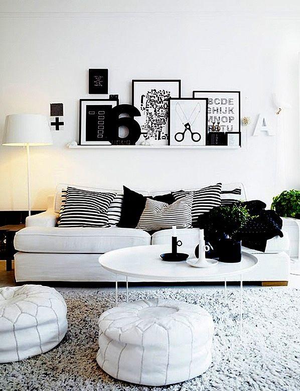 Afortunadamente la moda de las paredes desnudas va tocando for Decoracion encima sofa