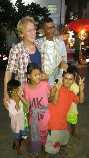 Siman and one of our supporters with the kids