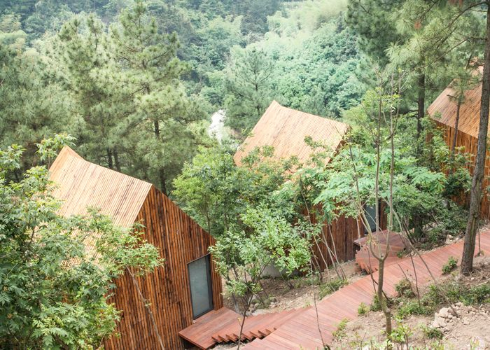 3 Wooden Spa houses between bamboo woods, Garden Valley - Mei Jie Mountain Hotspring resort in Liyang, China. by AchterboschZantman architecten #treehouse #path #bamboo #forest