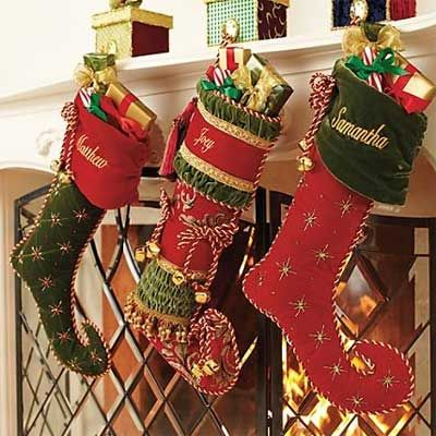 According to legend, one night St. Nicholas crept through a poor man's chimney to find stockings hanging to dry over the mantelpiece. He placed a bag of gold coins in each stocking and off he went. When the family woke up the next morning, they found the bags of gold coins and were of course, overjoyed.