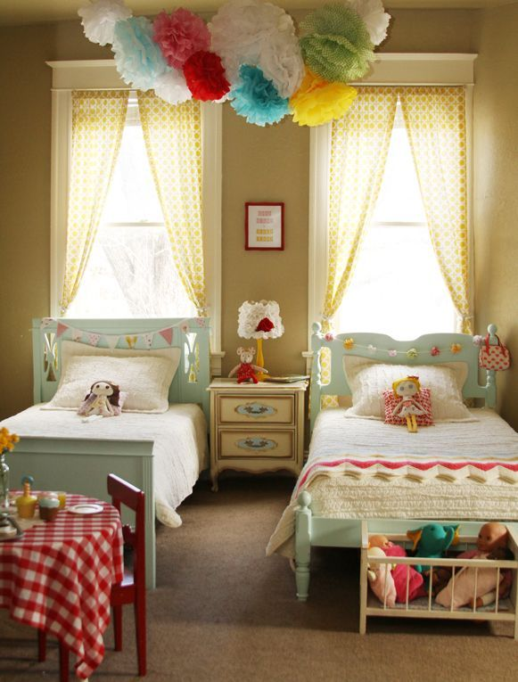 Vintage Charm Shared Girls Room by Christen Byrd! Love the teal beds, yellow curtains, and pom pom chandelier! This room is so cheery and bright!