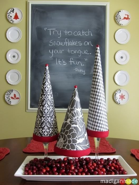 Wrap paper cones around them for a makeshift Christmas tree display. | 24 Clever Things To Do With Wine Glasses