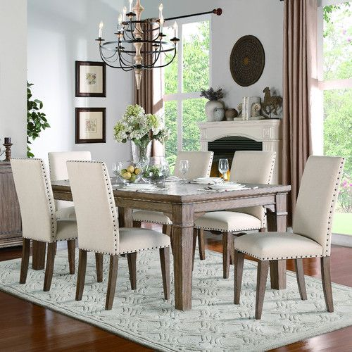 Features:  -Weathered wash.  -Mill Valley collection.  -The table has some degree of protection against spills, but not entirely.  -Chairs included: No.  Distressed: -Yes.  Top Finish: -Weathered wash
