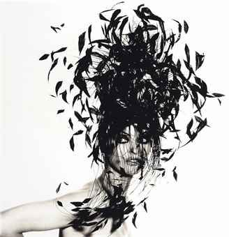 IRVING PENN (1917-2009)   WOMAN IN FEATHER HAT, NEW YORK, NOVEMBER 1991