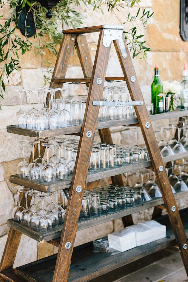 Make your wedding special with this makeshift drink station. Use a ladder and boards to construct the perfect station to store all your glasses and bottles. Impress all of your guests with this simple yet extremely functional ladder design that will blow other stations out of the water. See more of this Malibu wedding here: http://bridalmusings.com/2016/03/a-malibu-wedding-thats-both-elegant-epic/