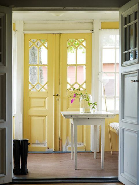Yellow Swedish styled doors. Hmmm..I wonder what something like this would like on my dining room French doors? Maybe not yellow. Aqua? Too much w curtains?