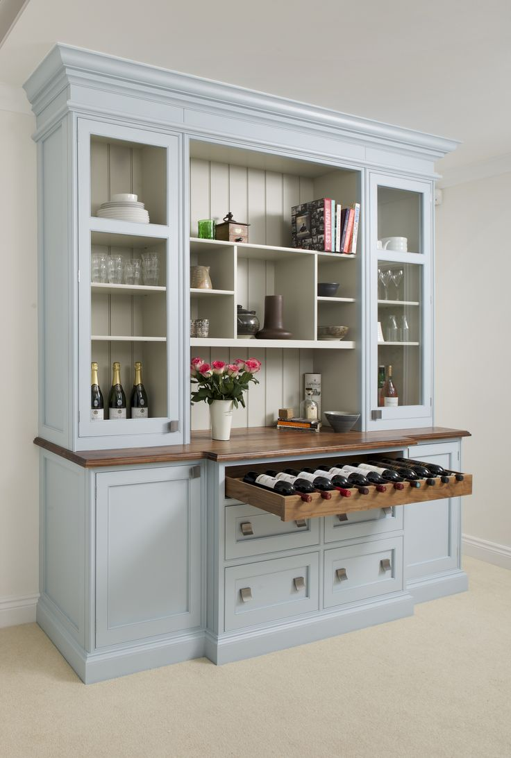 This Inglis Hall dresser painted in a pale blue with a white back panel has been made to store its owners most important kitchen items. The pull out wine storage drawer is the perfect persona touch.