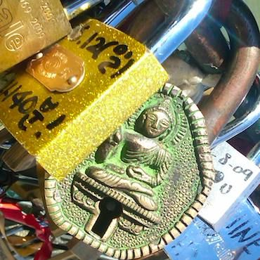 For those of you who haven't heard of them, here's the story. A couple writes their names on a padlock and locks it onto one of the bridges. They then throw the key into the Seine River as a symbol of their undying love.