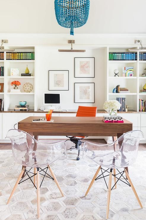 Emily Lister Interiors - Chic office features a turquoise beaded chandelier illuminating a mid century modern desk lined with an orange leather task chair, Eames Management Chair, as well as two clear acrylic Eames chairs atop a white and gray hex rug.