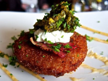 I have such a soft spot for Fried Green Tomatoes! Love this version from Magnolias at the Mill with goat cheese, pistachio relish, and tasso ham.