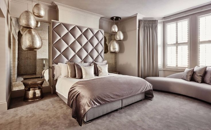 Sumptuous bedroom design by Eric Kuster with beautiful pendant fixtures that give the bedroom an almost extraterrestrial look. Elegant and Luxurious