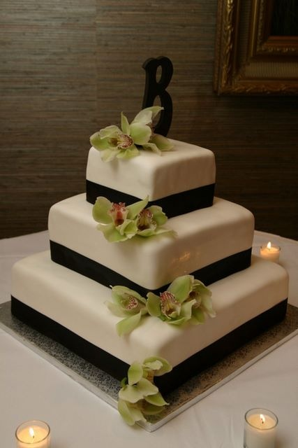 Square wedding cake with brown ribbon - love the brown ribbon on the white/ivory cake, but not so sure about the square shape. ( #wedding #cake)