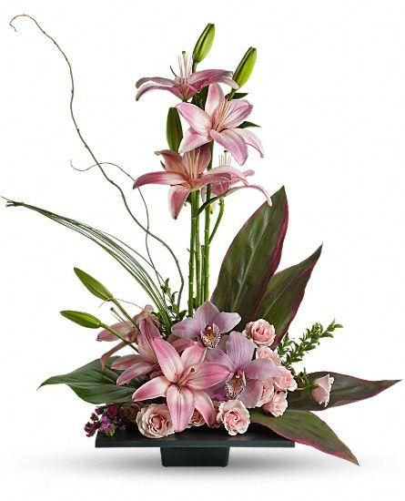 Flower arrangement Imagination Blooms - This composition of pink lilies, pink orchids and pink roses is memorably tranquil. A modern, square black dish is fille