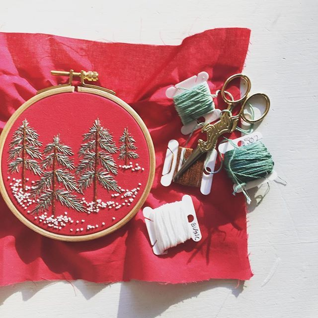 """My patriotic pines. This 4"""" pine ornament will be available in the #WelcomeJuniper #Etsy shop tonight! . . . . . #embroidery #embroideryart #hoopart #handmade #contemporaryembroidery #modernembroidery #bordado #pines #snow #winter #christmas #makersgonnamake #makersmovement #dmcthreads #embroideryinstaguild #craftastherapy #commonthreads #dstexture"""