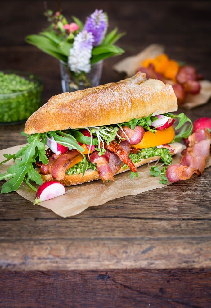 So I have been thinking of how to jazz up my lunch box in a tasty, easy and and eaten on the go way. Enter my *grilled smokey bacon and spring watercress pesto sandwich*, chock-a-block full of vegetables and spring rocket. It is the sort of sandwich that travels well and tastes good eaten cold.